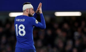 A bandaged Olivier Giroud acknowledges the acclaim of Chelsea supporters as he is substituted
