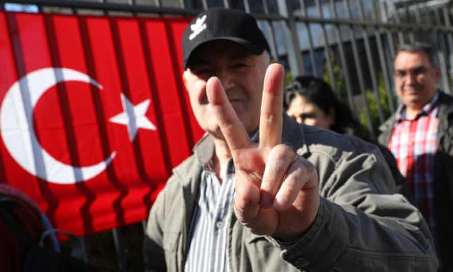 A man heading to the Turkish consulate in Berlin to vote for the Turkish referendum.