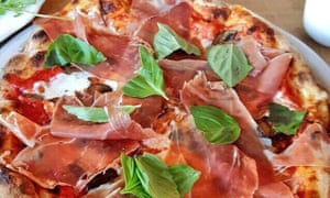 Close up of a prosciutto and rocket-topped pizza from Pizzeria Bianco, Phoenix, Arizona, US.