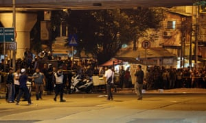 Indonesian police securing the blast site at Kampung Melayu bus shelter on Wednesday