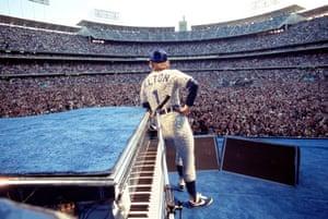 Elton John performing at Dodger Stadium in Los Angeles, October 1975, in a custom made Bob Mackie Dodger costume