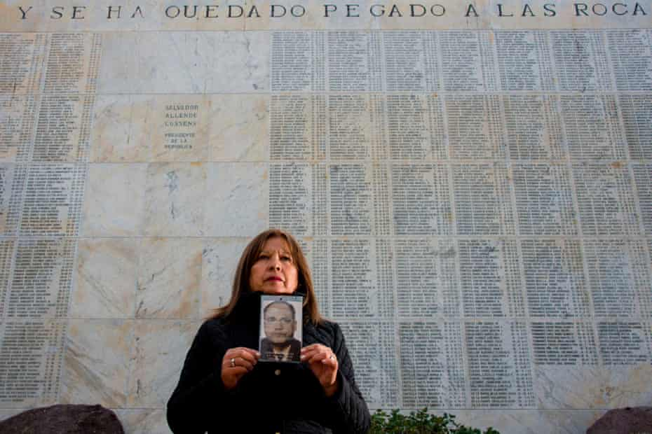 Juana Cerda, the daughter of Cesar Cerda, in front of the Memorial of the Missing and Executed Prisoners at the general cemetery of Santiago