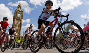 Cyclists pass Big Ben during a RideLondon event.