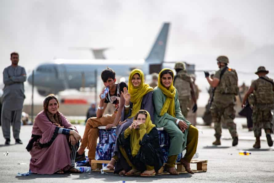 Evacuee children wait for the next flight after being manifested on 19 August at Kabul's airport.