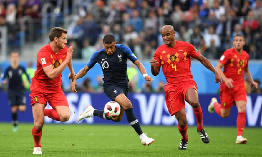 Kylian Mbappé (centre) is shadowed by Jan Vertonghen (left) and Vincent Kompany as France beat Belgium in the 2018 World Cup semi-final.