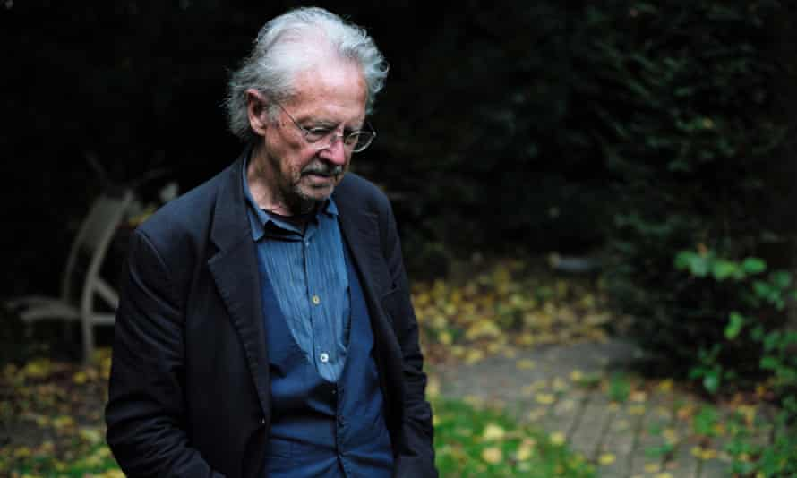 Peter Handke poses outside his home near Paris after winning the Nobel prize for literature.