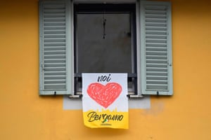 A banner reading 'We love Bergamo' hangs at a window in the upper part of the city.