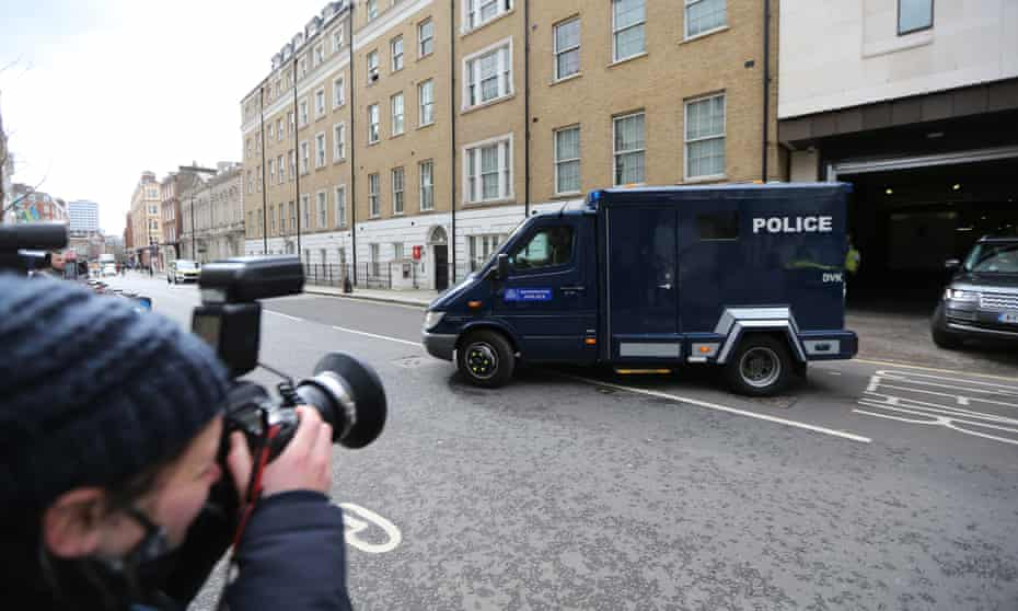 A police van carrying Wayne Couzens leaves Westminster magistrates court in March.