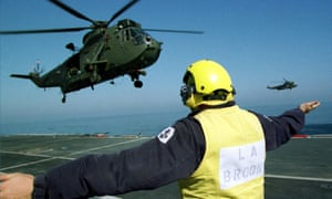 A Sea King helicopter leaves the deck of ship
