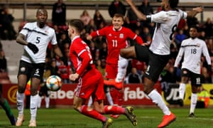 Ben Woodburn scores the winning goal for Wales in their friendly against Trinidad and Tobago