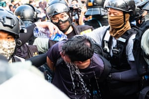 Riot police arrest a young protester during a rally in Tsim Sha Tsui district. Hong Kong anti -government pro-democracy activists continue into the fifth month of protests