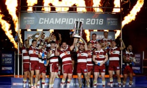 Wigan Warriors celebrate victory with the trophy.