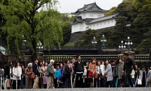 Japanese people and tourists visit the Imperial Palace, where Japan's Emperor Akihito is attending ritual ceremonies to abdicate