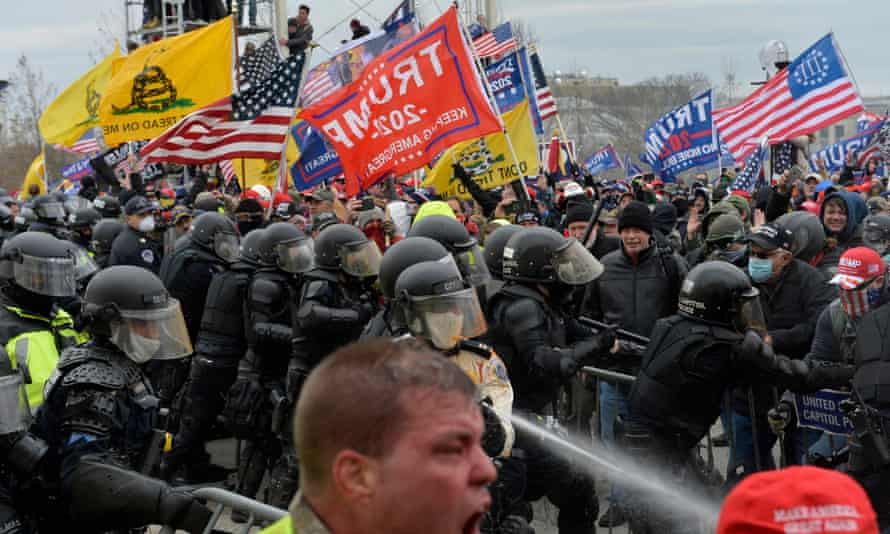 Trump supporters clash with police and security forces on 6 January at the US Capitol. Trump was banned from Facebook the next day.