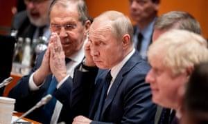 Sergei Lavrov, Vladimir Putin and Boris Johnson attend the Libya summit in Berlin on 19 January 2020.