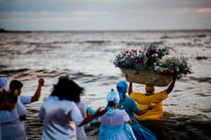 Montevideo, UruguayAn Umbanda priest launches a basket with offerings to Iemanjá, a goddess of the sea, at Ramirez beach