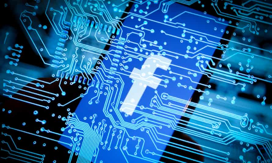 A Facebook logo is seen on an iPhone