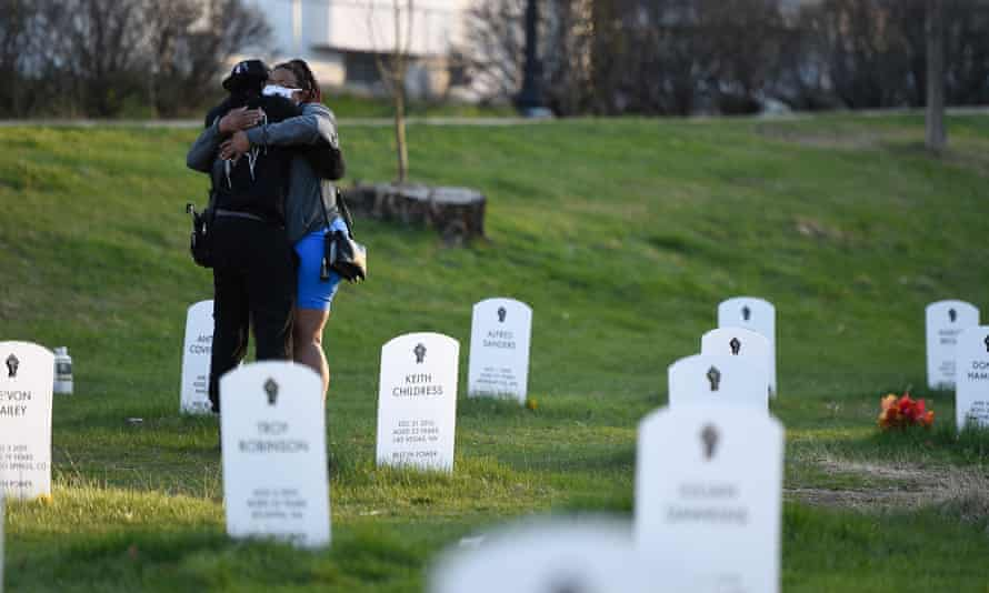 Two people hug at the 'Say Their Names' cemetery that memorializes Black Americans killed by police, in Minneapolis.