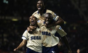 Ashley Cole, Patrick Vieira and Sol Campbell celebrate as  Arsenal beat Manchester United 1-0 at Old Trafford to win the 2001-02 title