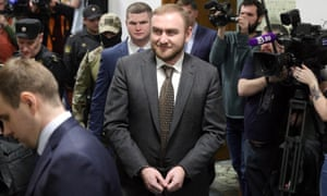 Handcuffed Rauf Arashukov is brought to Moscow's Basmanny district court