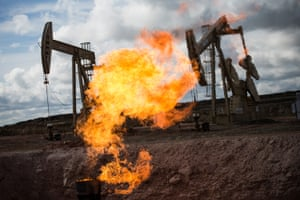 Flames flare up when excess flammable gases are released by pressure release valves during the drilling for oil and natural gas at a site in North Dakota, US.
