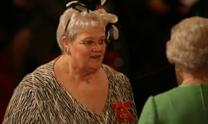 Penny Jones receiving her MBE from the Queen.