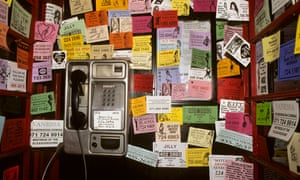 A phone booth full of prostitutes' business cards in London