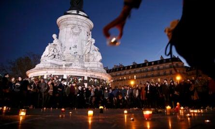 Candles are lit during a vigil in Place de la République, Paris
