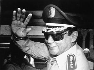 Noriega waves to journalists after a state council meeting at the presidential palace in Panama City in 1989