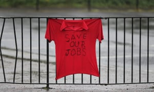 A t-shirt strapped to railings says 'Save our jobs.'