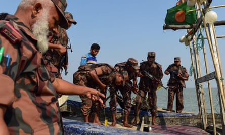 Bangladesh border guards search a fishing boat for drugs as part of the crackdown on the narcotics trade that has left 50 dead in one week.