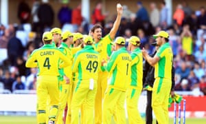 Mitchell Starc celebrates a wicket surrounded by teammates
