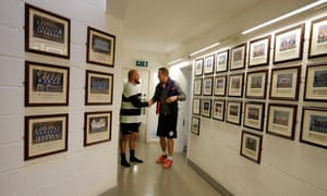 Ex England player and World Cup winner Will Greenwood, right, who is an assistant coach this week, shakes hands with New Zealand World cup winner Ben Franks in the Latymer School clubhouse before Barbarians training
