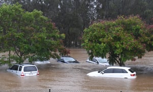 Cars sit in flood waters outside in south-east Queensland.