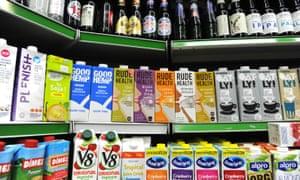 Oat milk and hemp-based drinks stacked below craft beers in the Hackney Food Center.