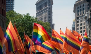 Participants wave flags during the Pride march in New York City, on 26 June 2016.