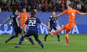 Saki Kumagai of Japan handles the ball from a shot from Vivianne Miedema of Netherlands to lead to the penalty.