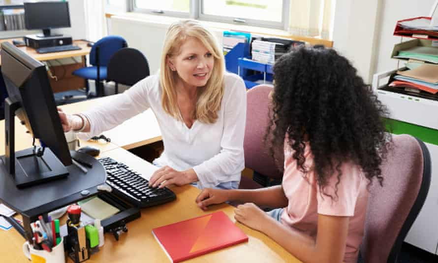 a careers adviser with a student