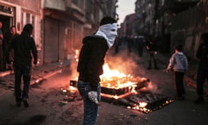A masked man holds a petrol bomb during protests in Istanbul against Turkey's military operations against Kurdish rebels.