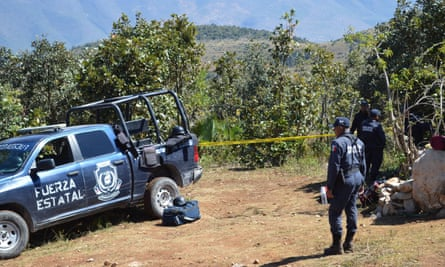 Mexican police officers in Zitlala, where 32 bodies and nine heads were recovered.