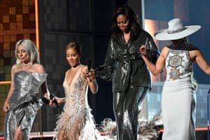 Lady Gaga, Jada Pinkett Smith, Michelle Obama, and Jennifer Lopez walk onstage