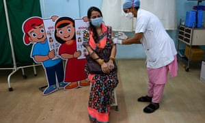 A woman gets inoculated with a dose of Covishield vaccine at the Rajawadi hospital in Mumbai.