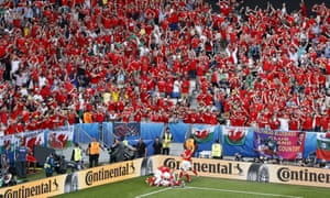Hal Robson-Kanu is mobbed by team-mates as Wales fans celebrate what turned out to be the winning goal against Slovakia.