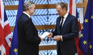 UK envoy Tim Barrow (left) hands Donald Tusk the letter giving Britain's formal exit notice.