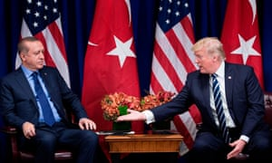 Donald Trump reaches to shake hands with Turkey's president, Recep Tayyip Erdogan, in New York City on 13 December 2017.