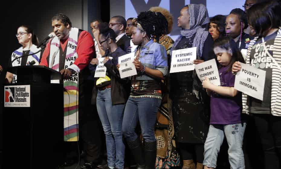 The Rev William Barber and the Rev Liz Theoharis, co-chairs of the Poor People's Campaign, speak at the National Civil Rights museum on 3 April.