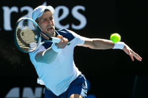 Novak Djokovic enjoyed a winning return against Donald Young at the Australian Open on Tuesday after six months out with an elbow injury.