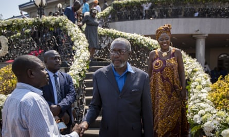 Leo Mugabe, centre, Robert Mugabe's nephew and the family's spokesman, at the late Zimbabwe president's official residence in Harare.