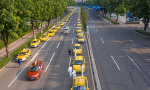 Aerial view of taxis waiting for students who sit the 2021 National College Entrance Exam (aka Gaokao) outside an exam site on 7 June 2021 in Guangzhou, Guangdong Province of China.