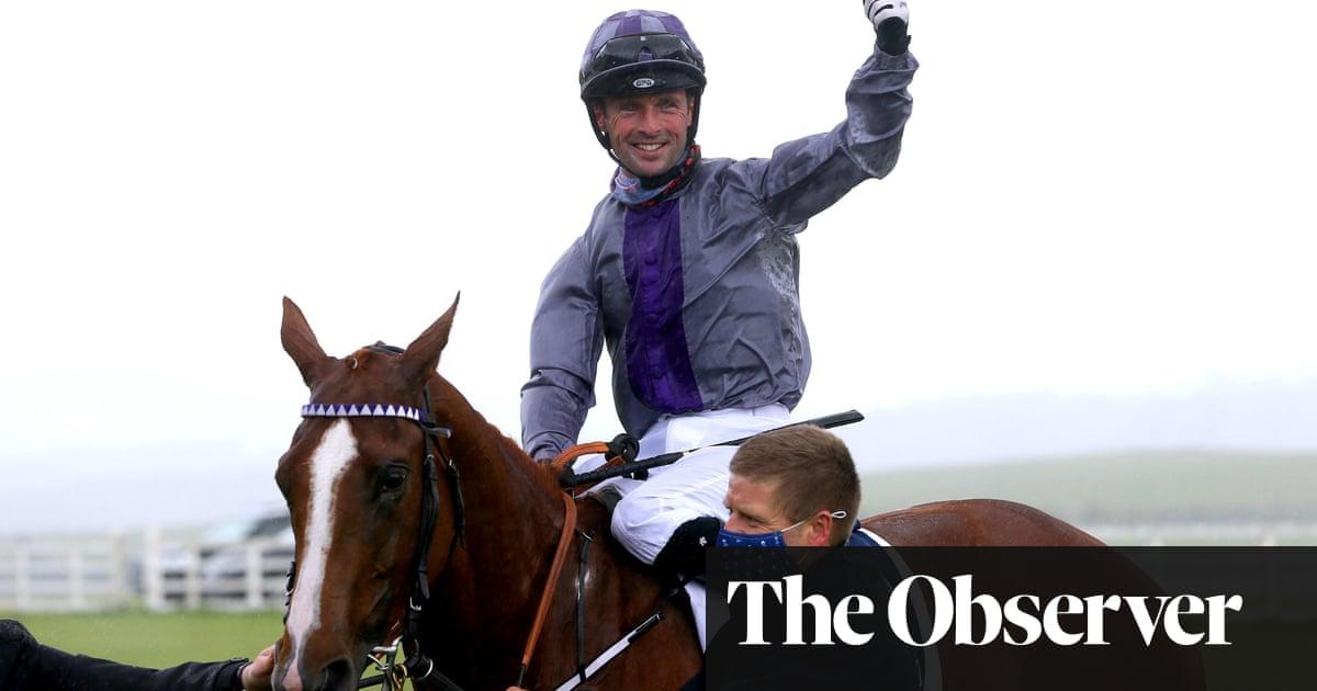 Mac Swiney holds off Poetic Flare to win Irish 2,000 Guineas in the rain